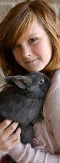 Teen girl with gray pet rabbit