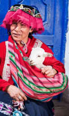 Peruvian woman with young lamb