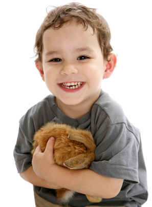 Having a rabbit as a pet certainly agrees with this very happy boy