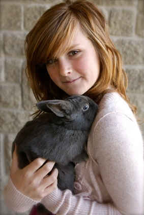 Teen girl with pet gray rabbit